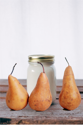 Image of a jar of yogurt and 3 golden pears
