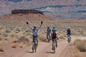 Cyclists in the desert (exercising)