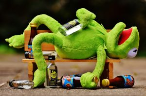 Alcoholism - Kermit the Frog passed out drunk on a Park Bench, bottles everywhere
