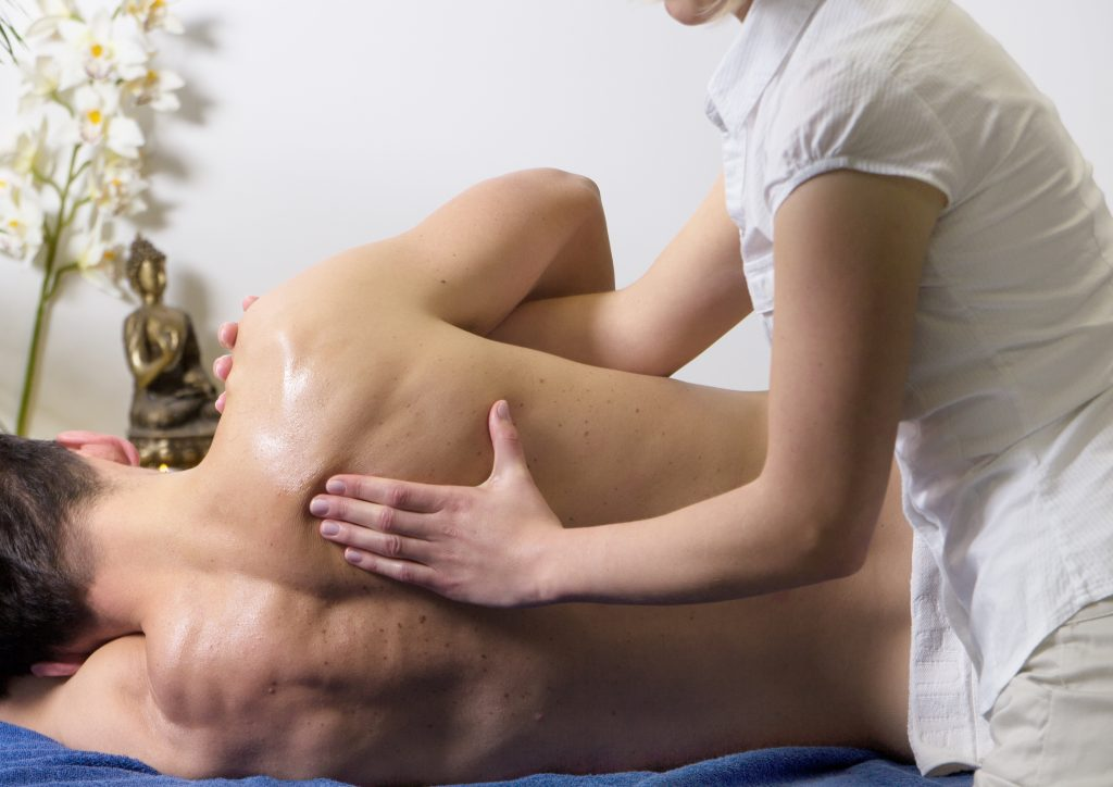 Man receiving massage for Bursitis