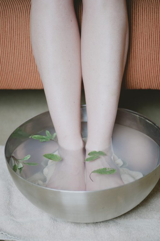 Image of a woman's feet in a tub of water
