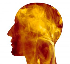Image of the outline of a man's head filled with fire