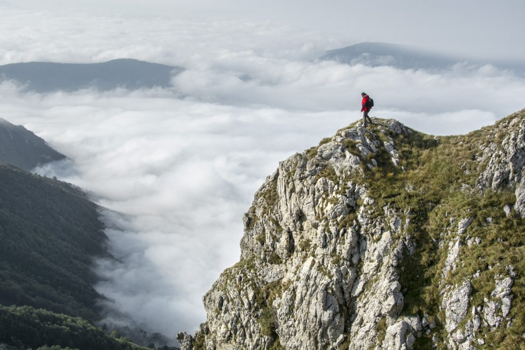 Image of a backpacker on a tall mountain