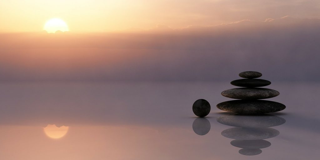 Ayurveda - Stones balanced atop one another on the beach