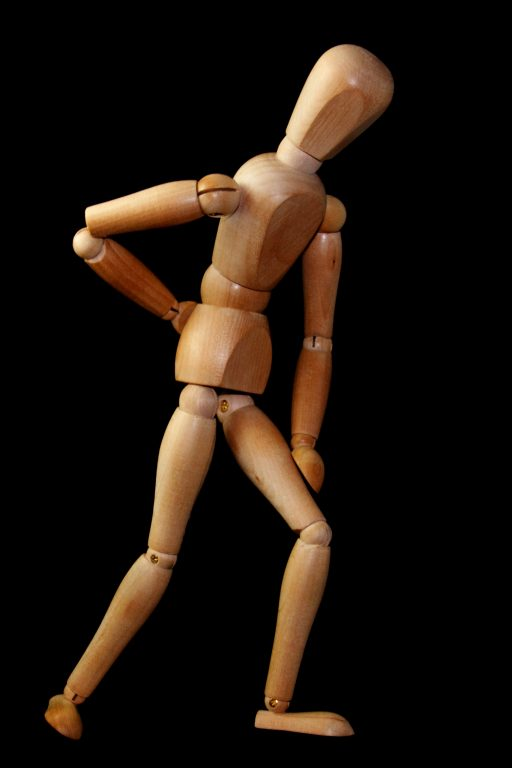 Back pain - Image of Wooden figure clutching back