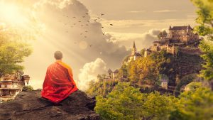 Adrenal Fatigue - Buddhist Monk Meditating on Hillside