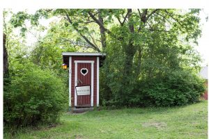 Constipation - Image of an outhouse with a Do Not Disturb sign