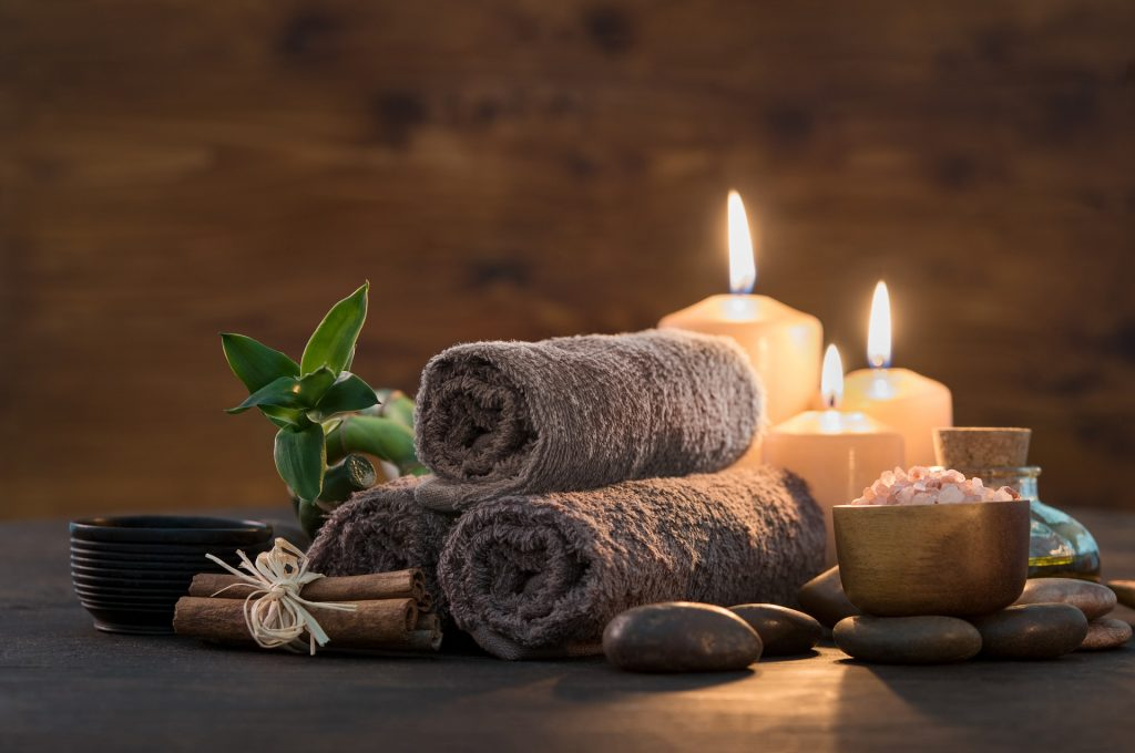 Massage - Image of candles, towels, stones