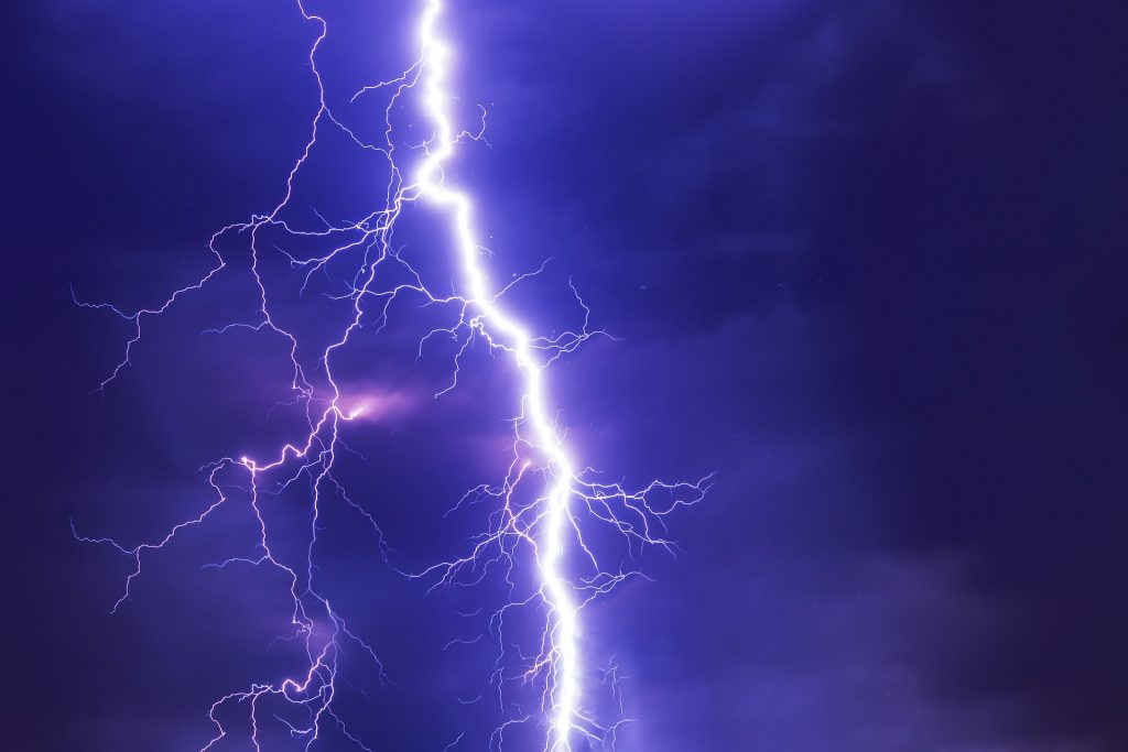 TENS - Image of a lightning bolt against a dark blue sky