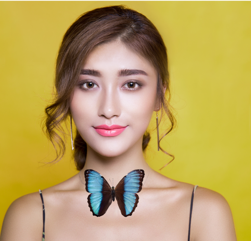 Image of a girl with a butterfly at her neck
