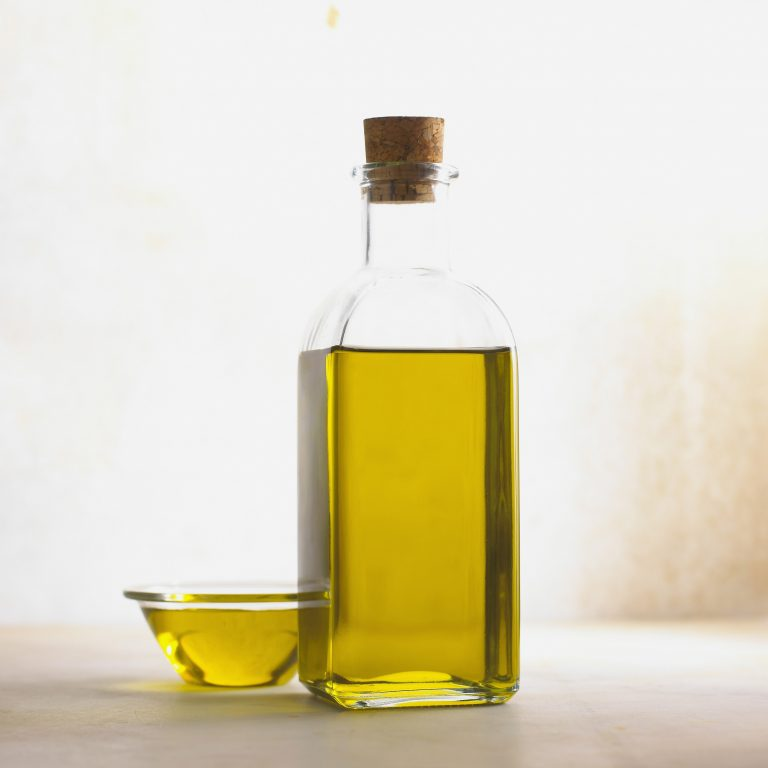 Image of a jar and small dish of oil