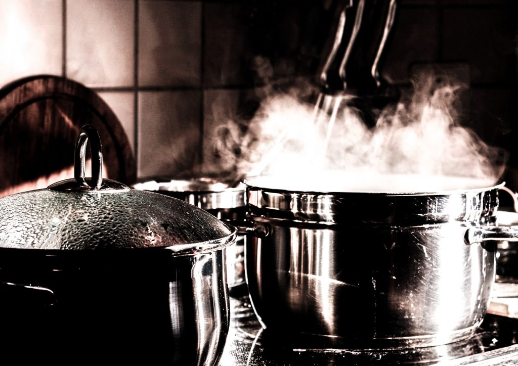 Image of steaming pots on the stove
