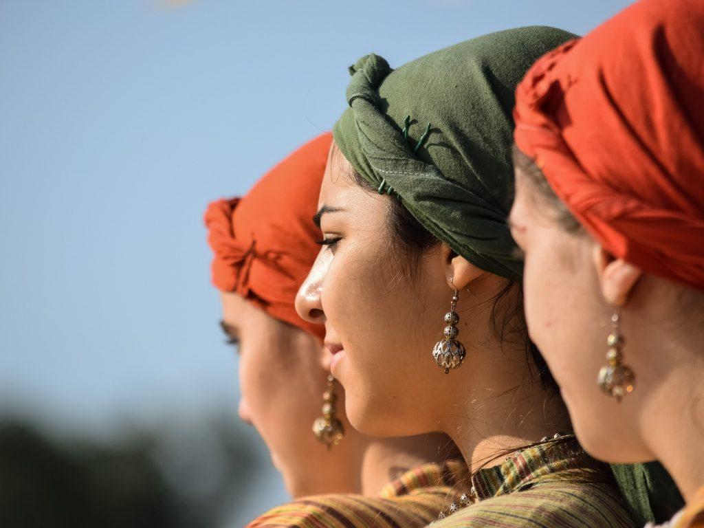 Image of three women with head scarves and pierced ears