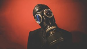 Image of a person in an old-fashioned gas mask