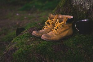 Image of a pair of hiking boots on a mossy rock