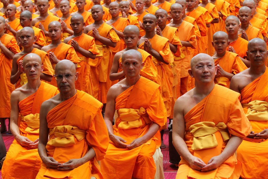 Hair Loss - Image of a large group of bald/shaven monks