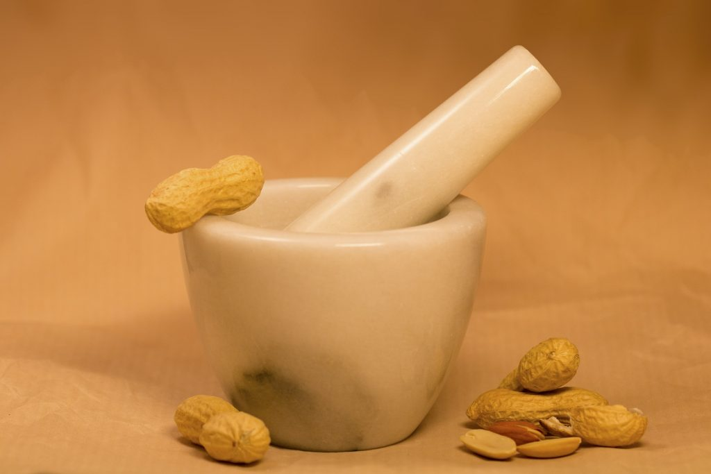 Image of stone mortar and pestle and peanuts