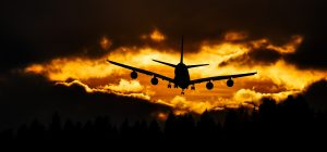 Aircraft landing at sunset