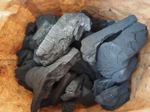 a small pile of carbon coal